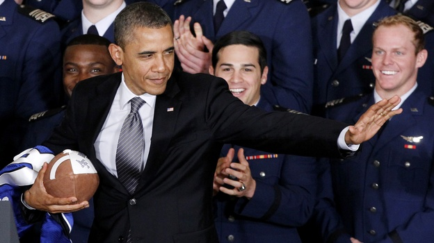 President Obama strikes the Heisman Trophy pose after he awarded the Commander-in-Chief Trophy to the Air Force Academy football team in April 2012. (AP)