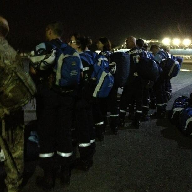 "NPR's Jason Beaubien, who is on assignment in the Philippines, posted this photo on Thursday. He writes that he was ""waiting with a French search and rescue team to board a night flight"" on a military plane from Manila to the devastated city of Tacloban."