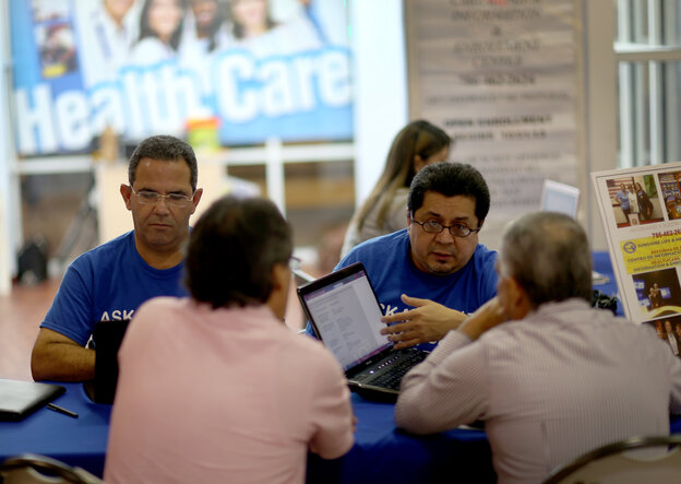 Insurance agents in Miami, Fla. help people with information about policies that are available to them under the Affordable Care Act on Nov. 5, 2013.