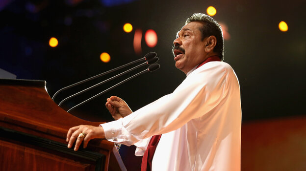 Sri Lankan President Mahinda Rajapaksa speaks during the opening ceremony of the Commonwealth Heads of Government Meeting in Colombo, Sri Lanka.