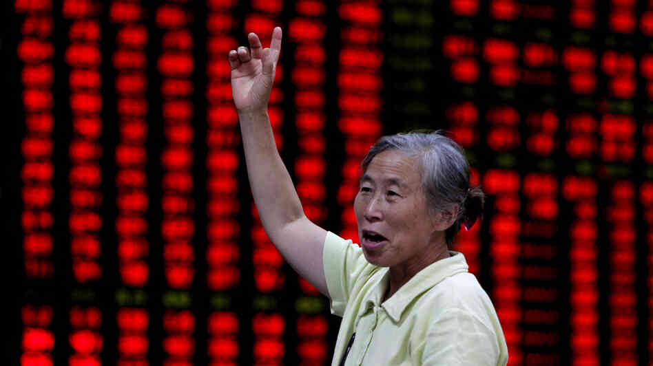 An investor is seen at a brokerage house in Shanghai, China, on Aug. 16.