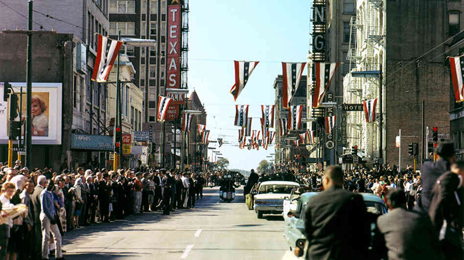 The presidential motorcade travels down Main Street in Dallas on Nov. 22, 1963, the day President John F. Kennedy was shot.