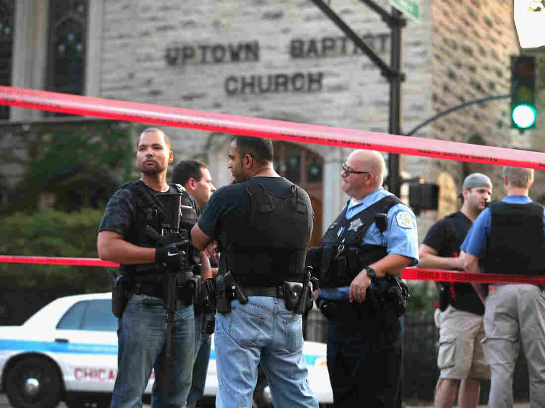 Chicago police investigate a shooting in front of the Uptown Baptist Church in August. Five people were shot, one fatally, during the drive-by, in which gunmen fired more than 20 rounds.