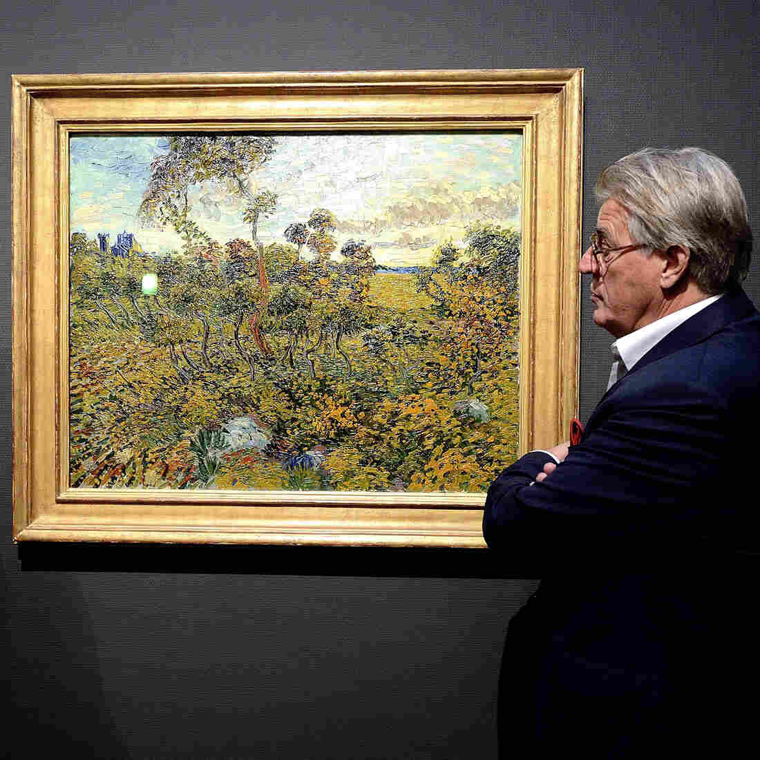 Museum director Alex Rueger (L) and Dutch artist Jeroen Krabbe stand in front of Vincent van Gogh's long-lost Sunset at Montmajour at the Van Gogh Museum in Amsterdam. The 1888 landscape painting from the height of the Dutch master's career had been abandoned for years in a Norwegian attic on the belief that it was a forgery.