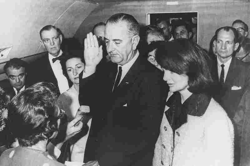 Federal Judge Sarah Hughes administers the oath of office to Vice President Lyndon Johnson as he assumes the presidency following the assassination of President Kennedy in Dallas. Johnson's wife, Lady Bird (left), looks on with Mrs. Kennedy.