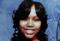 A photo of Renisha McBride on a program at her funeral service in Detroit. Murder charges have been filed over McBride's death from a shotgun blast at a house in Dearborn Heights, Mich., on Nov. 2.