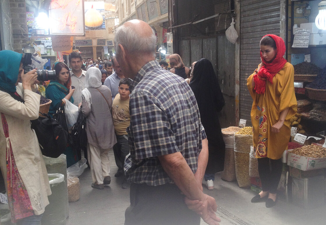 Afra Pourdad photographs Shabnam Molavi in a crowded bazaar.