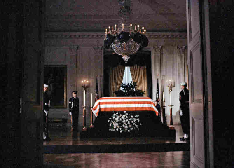 The flag-draped coffin of President Kennedy lies in state in the East Room of the White House on Nov. 23.