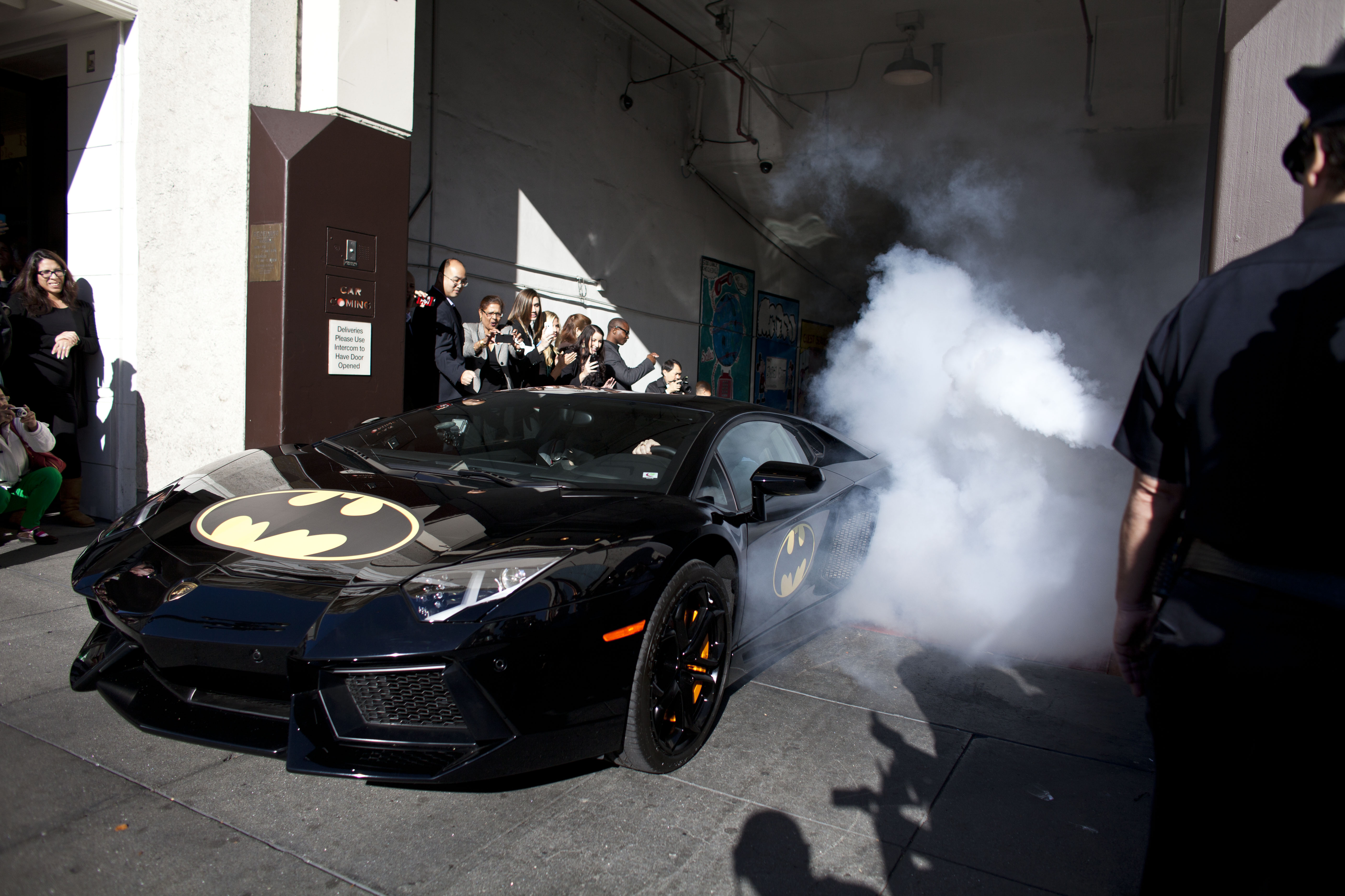 To the Batmobile! Batkid exits his cave at Union Square.