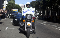 A San Francisco police officer shows solidarity with Batkid.