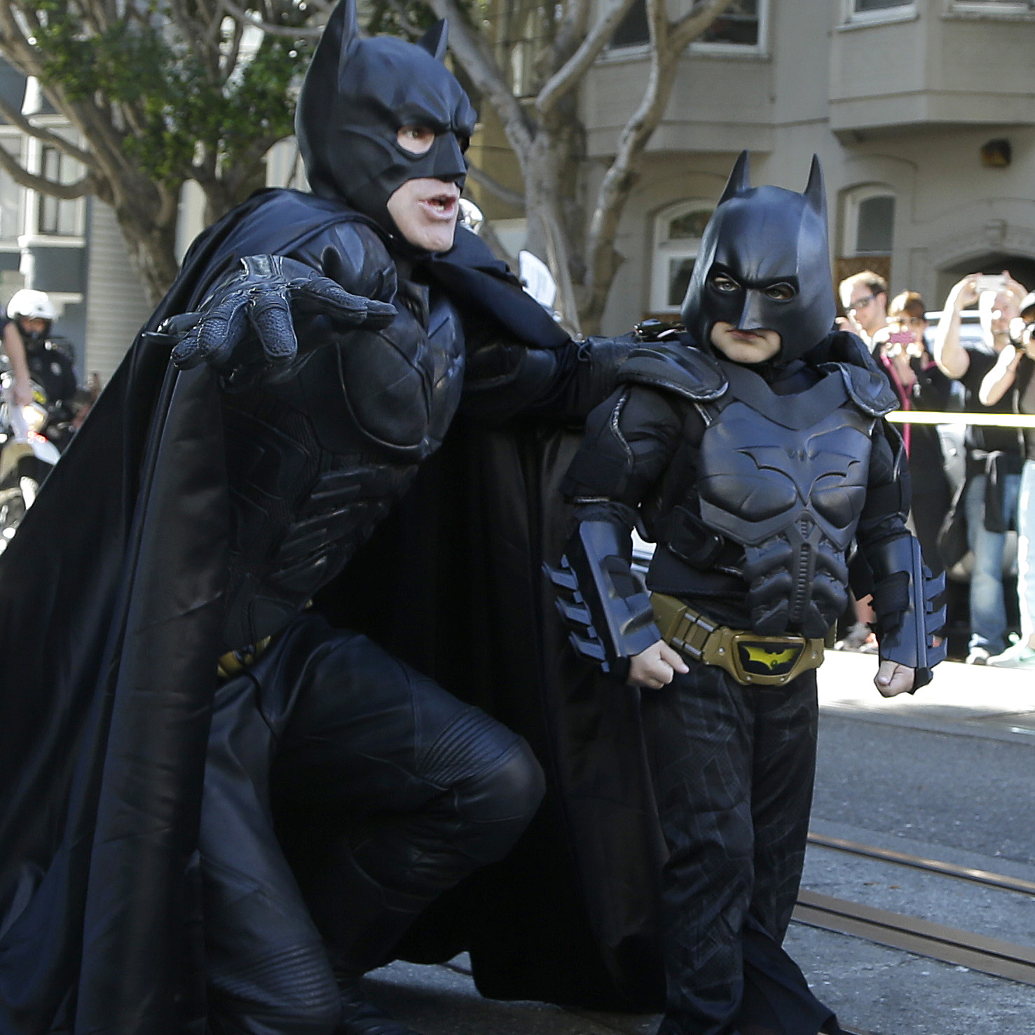 Miles Scott, dressed as Batkid, talks strategy with Batman before saving a woman from peril in San Francisco on Friday. The Make-A-Wish Foundation turned the City by the Bay into Gotham City for Miles, creating a daylong event to grant the leukemia survivor's wish to be a superhero.