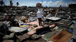 A boy stands amid ruins in Tacloban, the Philippines. The city of 220,000 was devastated by Typhoon Haiyan.
