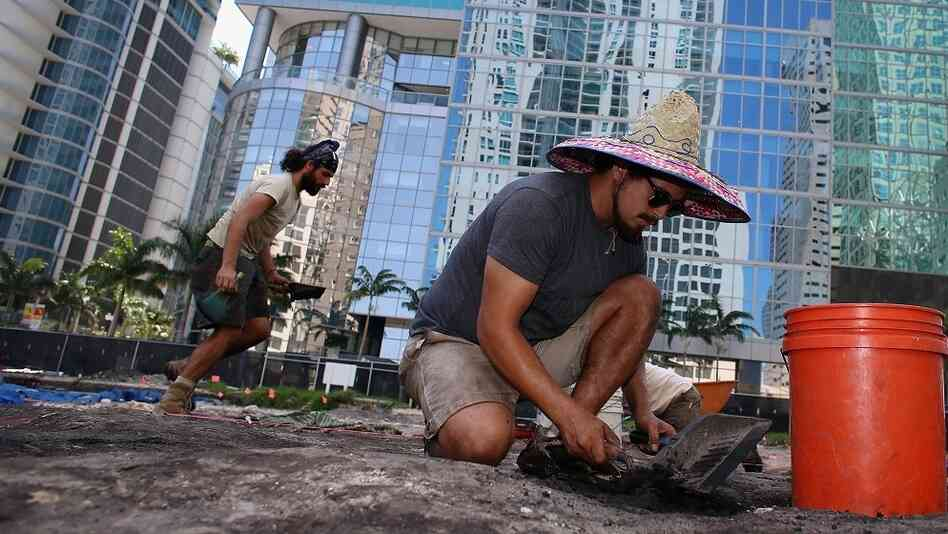 In the middle of downtown Miami, archaeologists excavate a site holding evidence of a more than 1