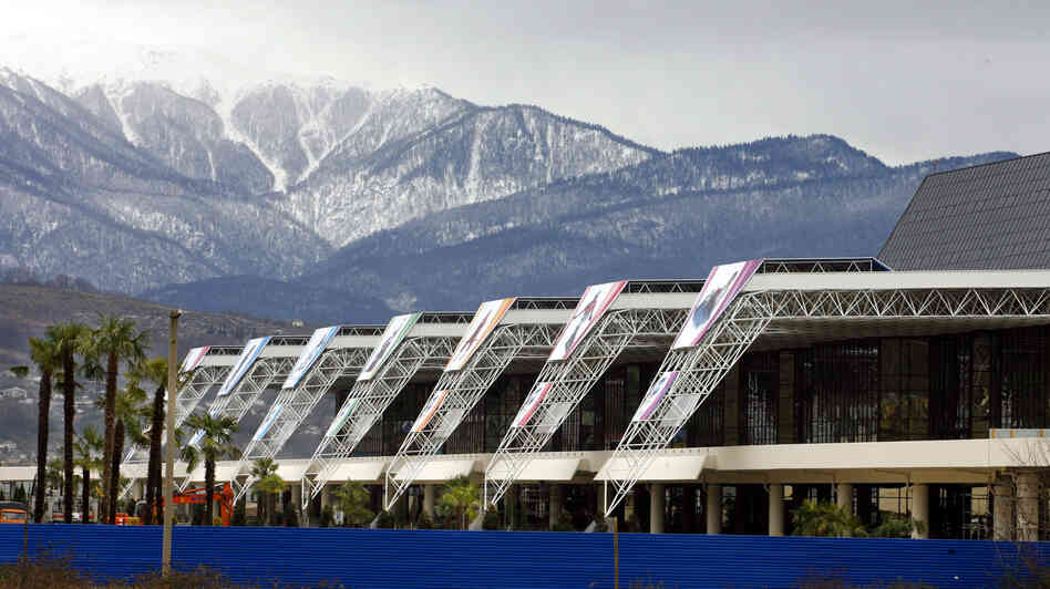 What's a few palm trees? Soaring snowcapped peaks and the aforementioned palms rise near the airport in Sochi, Russia, host of the 2014 Winter Games. Summer Olympics hosts Beijing and Stockholm are among the cities vying to win the 2022 Winter Games.