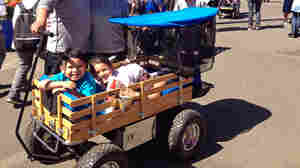 More Kids Roll In Style In Tricked-Out, Giant Wagons