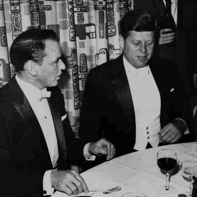 President John F. Kennedy sits with Frank Sinatra at his Inaugural Ball in 1961.