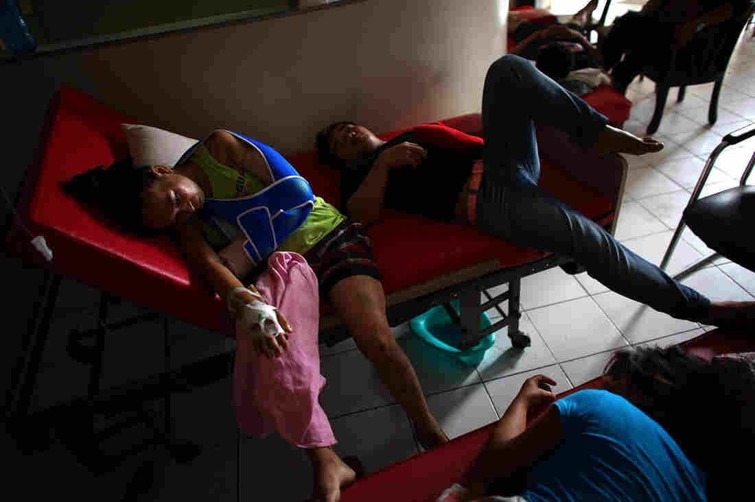 Patients lay in a makeshift waiting area in the halls of the Divine Word Hospital in Tacloban, Philippines, on Saturday.