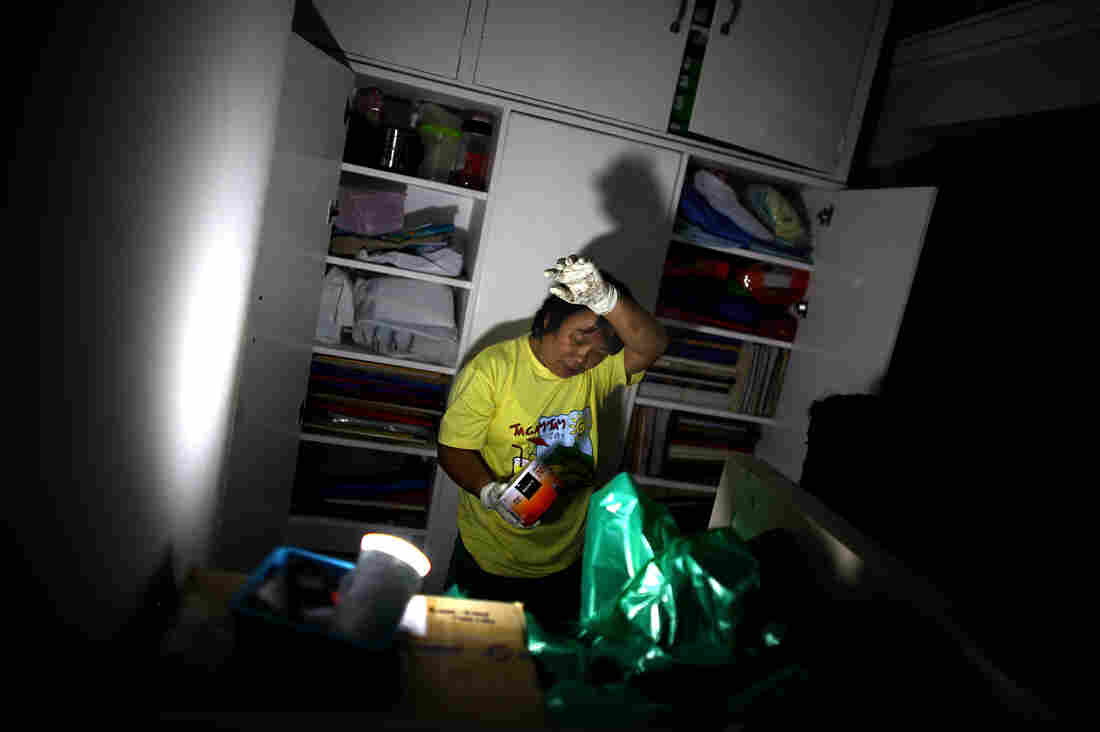 A nurse fights the heat and humidity in the lab of the Divine Word Hospital in Tacloban, Philippines, on Saturday.