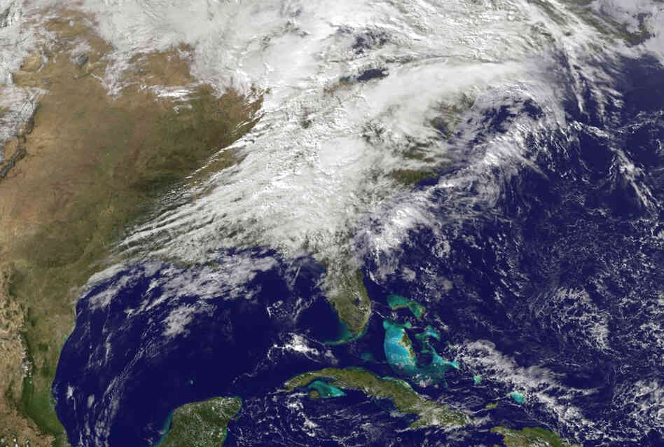 A satellite image showing severe weather as it moves through the midwest area of the United States on Sunday.