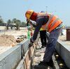 Foreign laborers work at the site of a new road in Doha, Qatar, last month. According to recent media reports, immigrants working on projects for the World Cup in 2022 have been subject to abuse and harsh working conditions.