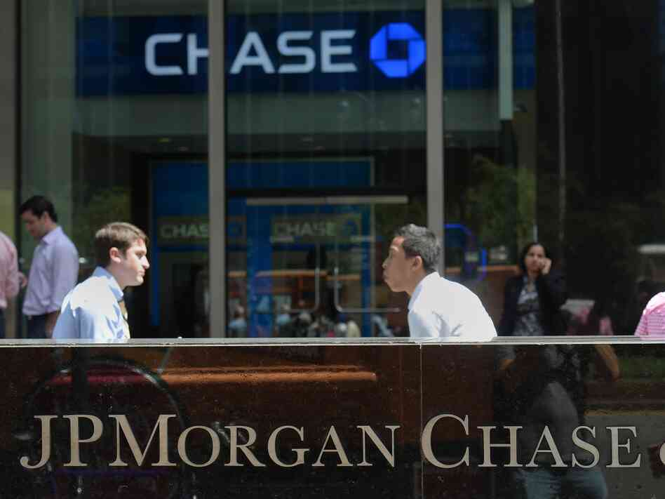 People walk by JPMorgan Chase & Co. headquarters in New York,