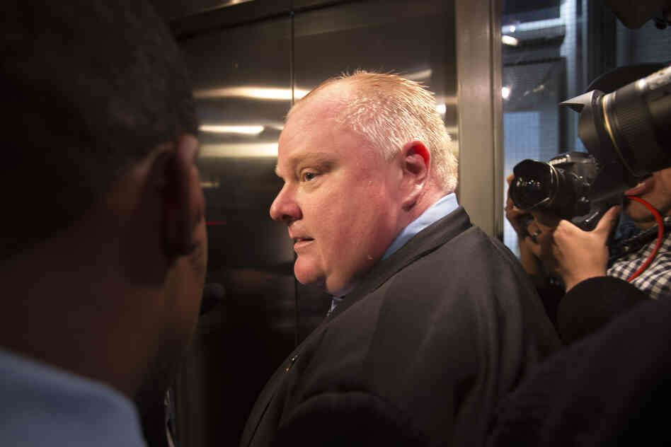 Toronto Mayor Rob Ford is surrounded by the media as he waits for an elevator outside his office at Toronto City Hall on November 15.