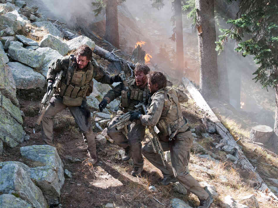 In Lone Survivor, Mark Wahlberg (left) stars as former Navy SEAL Marcus Luttrell, who was the lone survivor of a mission in Afghanistan in 2005.