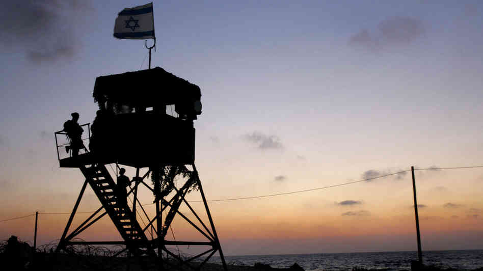 Israeli soldiers work from a Gaza Strip watchtower.