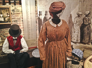 The Freedom House Museum exhibit features wiry mannequins in typical dress for slaves at auction.