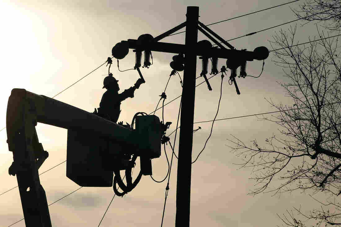 A lineman grounds a line on a replacement pole in McNeill, Miss., after 2012 Christmas day storms downed both telephone and electric power lines and poles throughout the state. Upkeep on traditional landlines is expensive, and some are