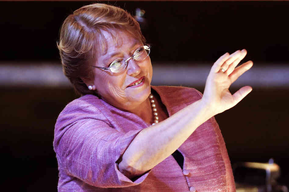 Former Chilean President Michelle Bachelet waves to suppo