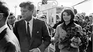 President John F. Kennedy and his wife, Jacqueline, are greeted by an enthusiastic crowd upon their arrival at Dallas Love Field on Nov. 22, 1963.