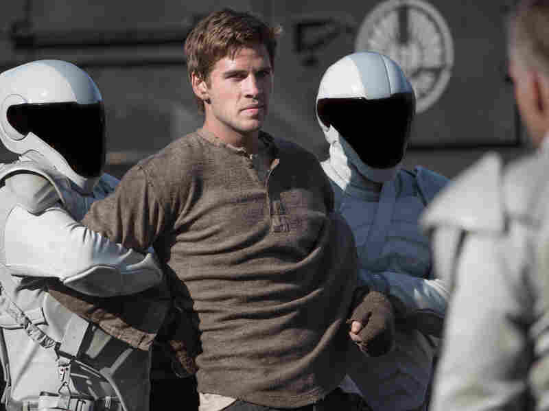 The third point of the movie's love triangle, Katniss' hunting partner Gale Hawthorne (Liam Hemsworth), remains stranded in District 12 without as much to do as the other two.