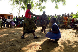 In a play written and staged by young people in Sandrack, Malawi, a mother and father tell their daughter she must drop out of school and get married. An older man has promised them a big dowry for their daughter's hand.