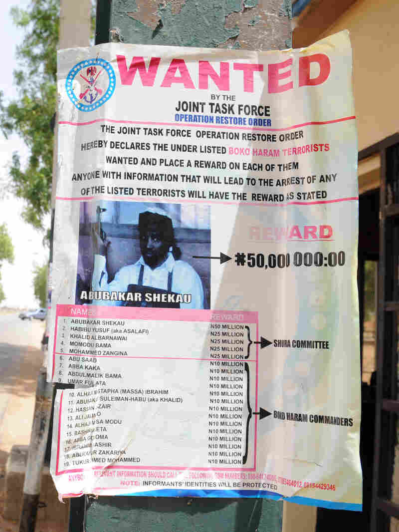A poster in the northeastern city of Maiduguri shows a photograph of Abubakar Shekau, a Boko Haram leader who has claimed responsibility for recent attacks. The U.S. has placed a $7 million bounty on Shekau.