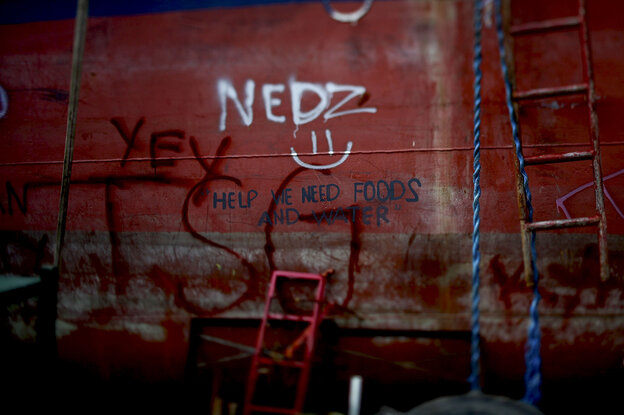 In Tacloban, the Philippines, graffiti on the side of a grounded ship sends a message out to the world.