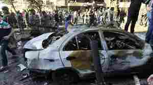 This car was among many vehicles destroyed by bombs Tuesday in Beirut. Nearby buildings suffered extensive damage. More than 20 people, including an Iran diplomat, were killed by the explosions near Iran's embassy.