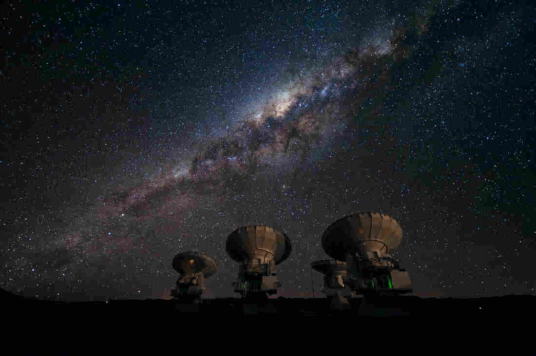 Part of the ALMA array on the Chajnantor plateau of Chile points skyward to the Milky Way, our own galaxy. The center of our galaxy is visi