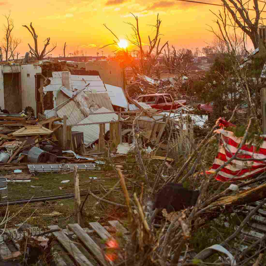 Washington, Ill., sits in ruins as the sun rises Monday, a day after a severe tornado tore through the community.