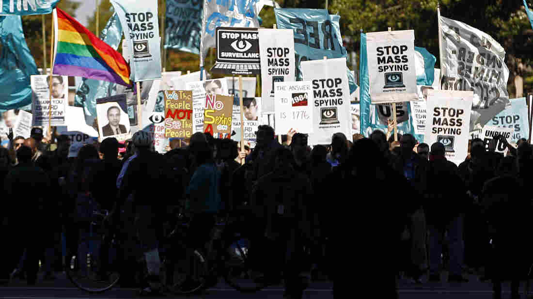 Protesters march on Oct. 26 to demand that the Congress investigate the National Security Agency's mass surveillance programs. Legally, the NSA can respond to many records requests from citizens with a non-committal answer.