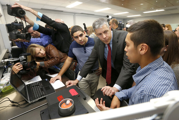 Education Secretary Arne Duncan tours a Wheeling, Ill., high school nanotechnology lab on Oct. 24.