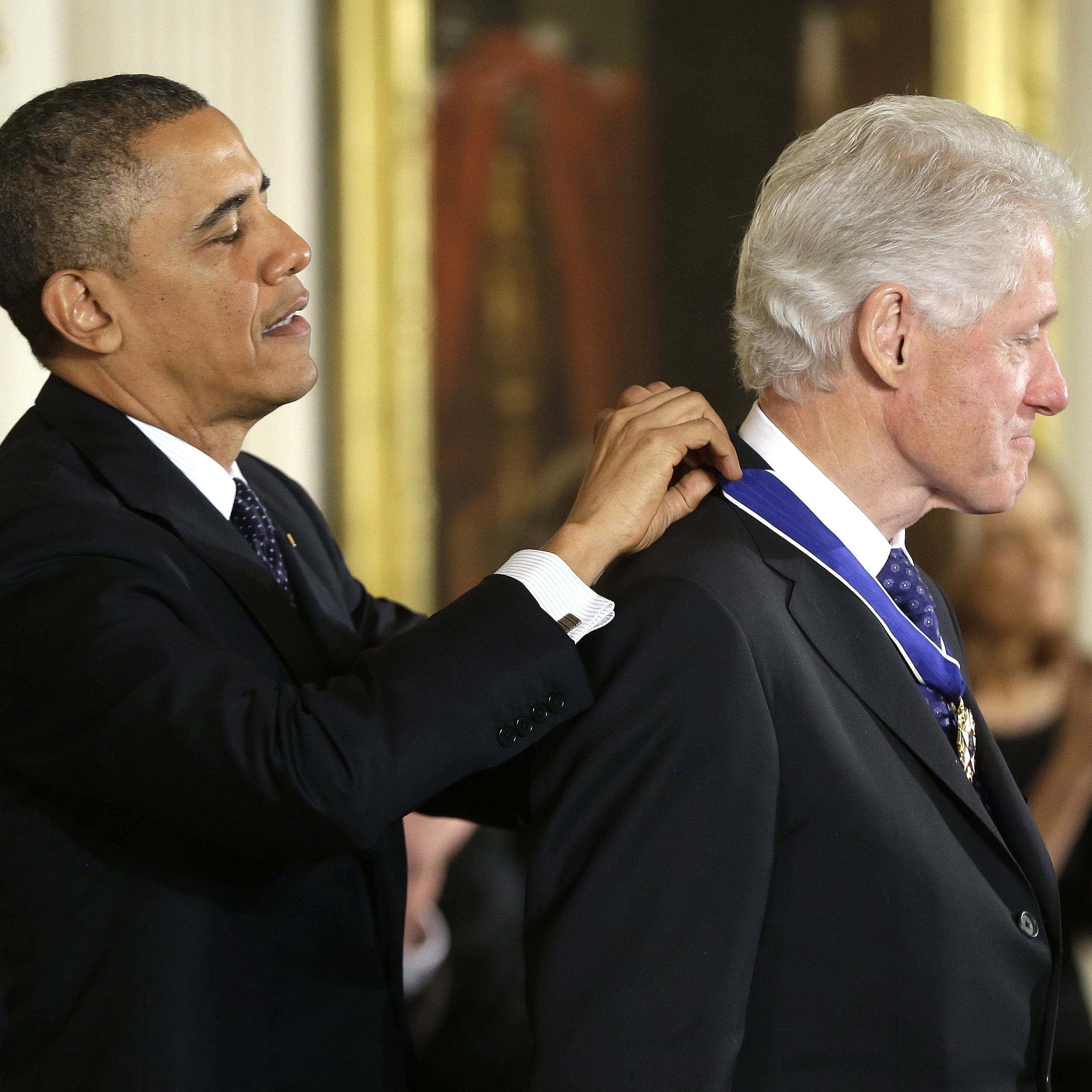 From one commander to another: President Obama awards former President Bill Clinton the Presidential Medal of Freedom.