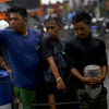 Filipino men stand in line to fill containers with gas in Tacloban, Philippines, on Sunday. The area experienced widespread gas shortages in the wake of Typhoon Haiyan.