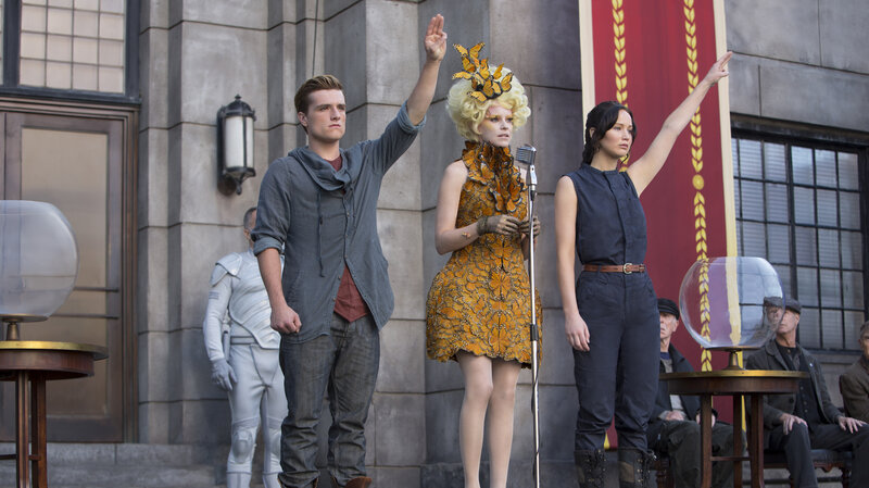 how does katniss show rebellion in the hunger games