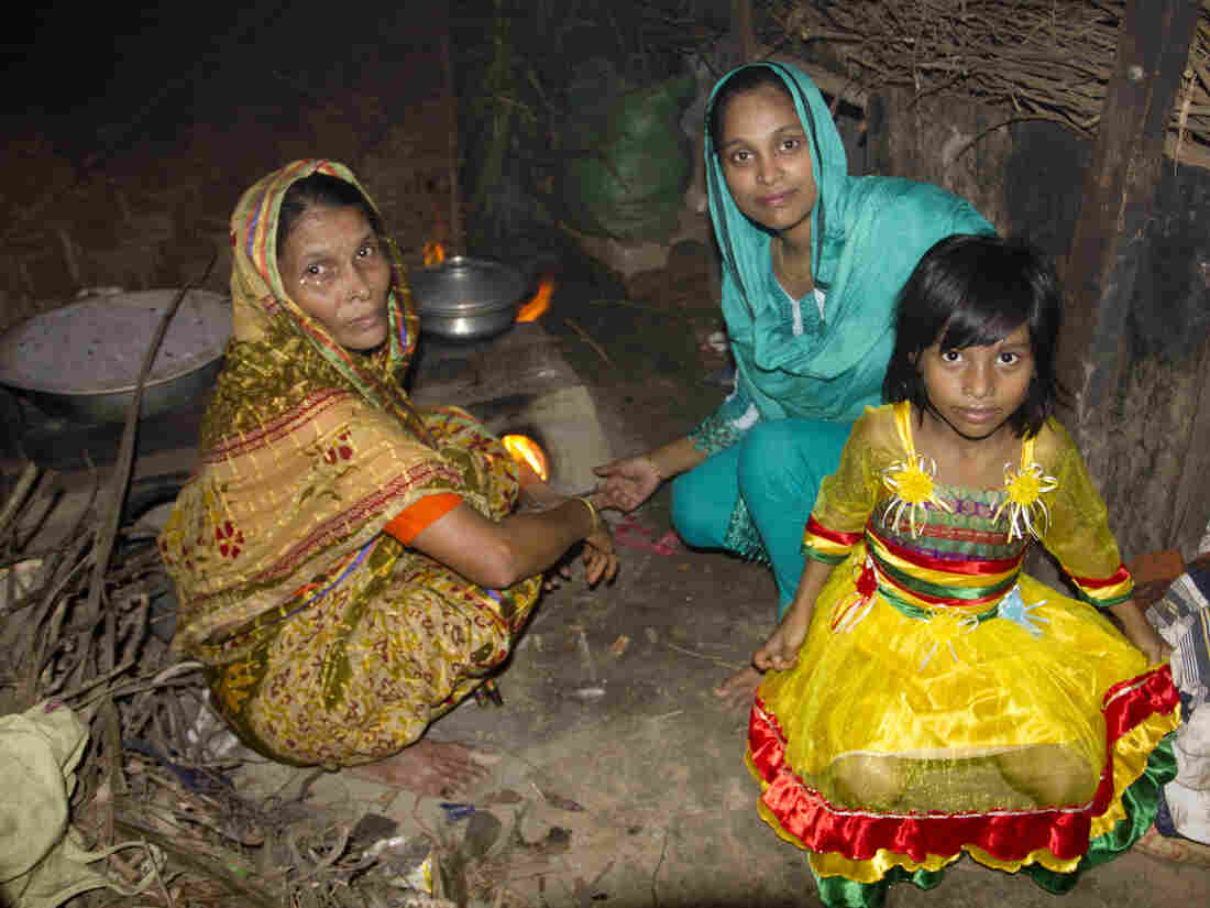 Minu's mother, Noor Jahan Begum, Minu, and Minu's daughter, Sumaiya, in the kitchen of Minu's parent's home.