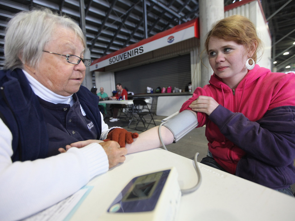 Low-income adults formerly had few options for free health care. Leah Sessor had her blood pressure taken on April 14, 2012, during a free clinic at a racetrack in Bristol, Tenn.