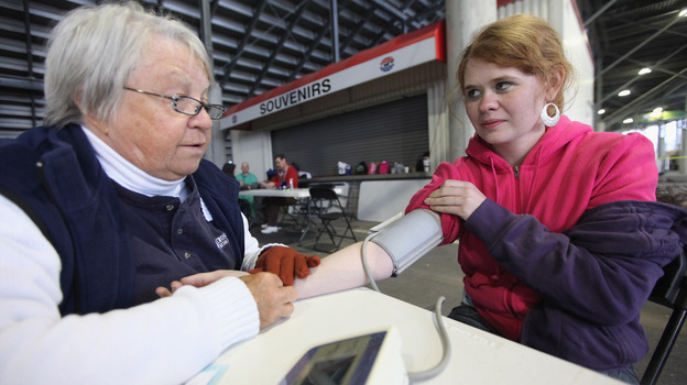 Low-income adults formerly had few options for free health care. Leah Sessor had her blood pressure taken on April 14, 2012, during a free clinic at a racetrack in Bristol, Tenn. (Getty Images)