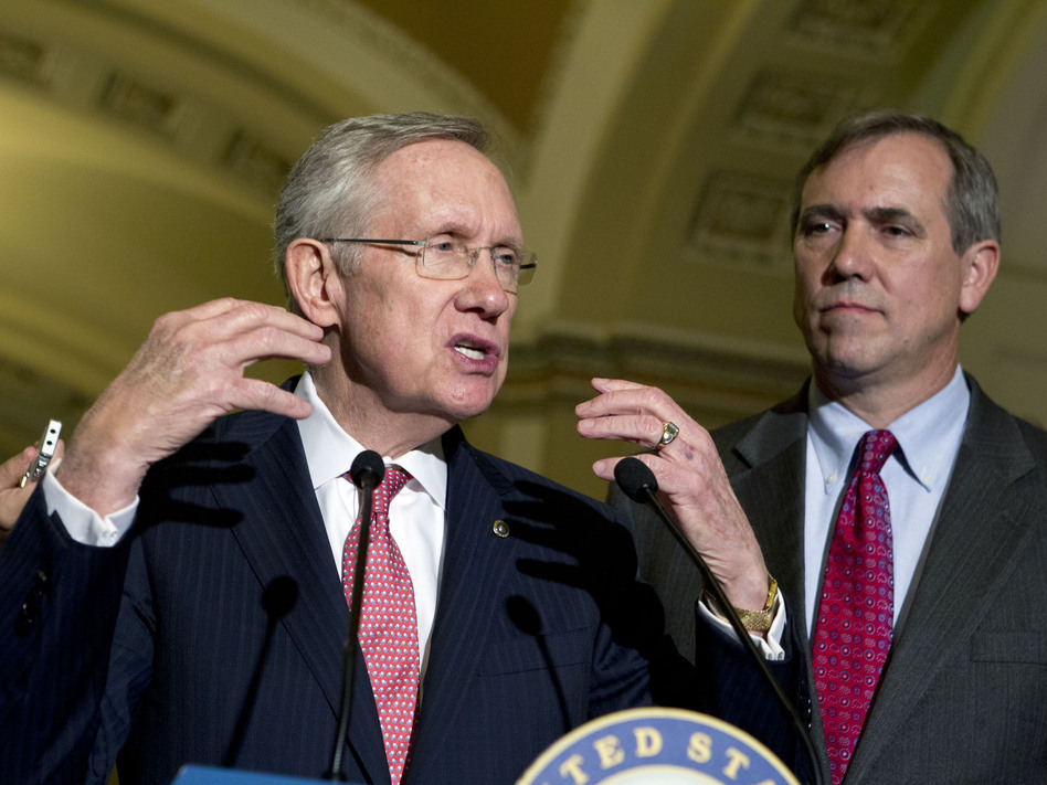 Senate Majority Leader Harry Reid (left) with Democratic Sen. Jeff Merkley on Capitol Hill in July. Both senators favor curtailing the minority's right to filibuster judicial nominees. (Jose Luis Magana/Reuters/Landov)