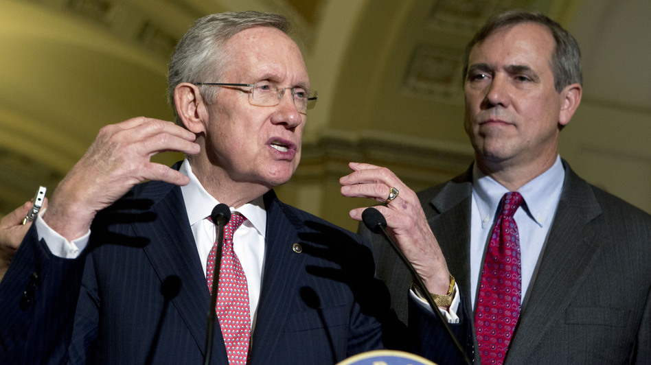 Senate Majority Leader Harry Reid (left) with Democratic Sen. Jeff Merkley on Capitol Hill in July. Both senators favor curtailing the minority's right to filibuster judicial nominees.
