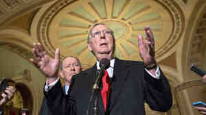 Senate Minority Leader Mitch McConnell of Kentucky (right) joined by Sen. Lamar Alexander, R-Tenn., speaks at a Capitol Hill news conference Thursday.